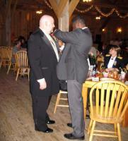 IMG_0716 Elton pins something (I'm not sure what) on Matt's jacket