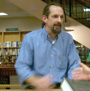 Neal Stephenson talks to a fan at a book signing at Book People in Austin, TX in 2003 or 2004